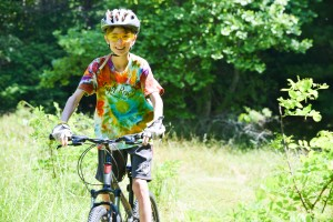 Camper Biking at Camp